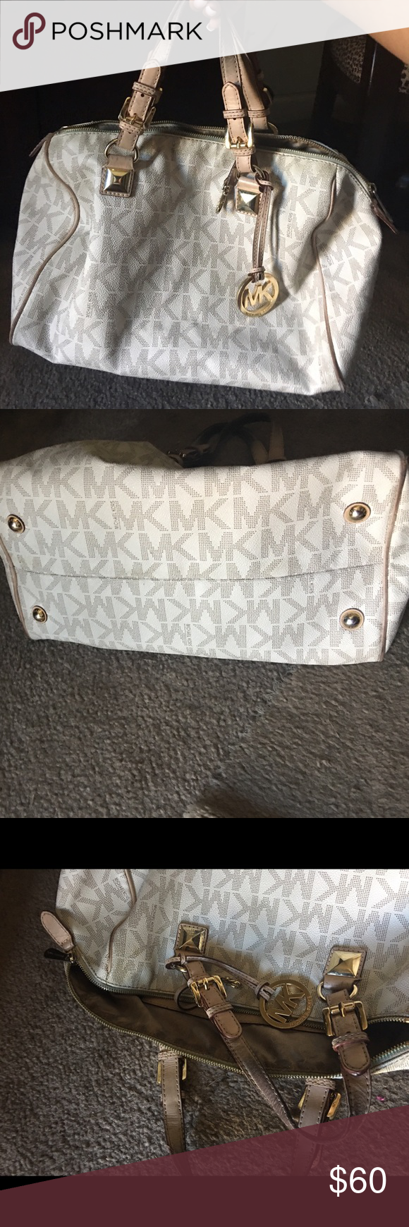 Mk handbag Was sent back good condition things that are wrong r n a pic handles need to b cleaned up cause of oils and zipper line can b cleaned as well  other than that nice MICHAEL Michael Kors Bags Satchels