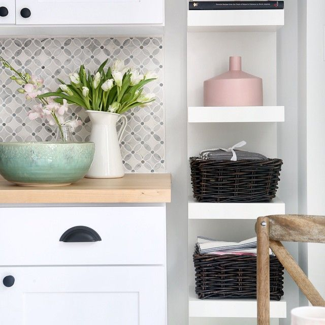 white kitchen cabinets | organization | wicker baskets | ikea | CB2 | butcher block countertop | mosaic marble backsplash | kitchen décor ideas | home staging ideas