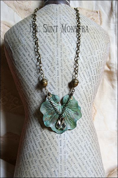 """https://www.facebook.com/hicsuntmonstra  """"Silvania"""" - a simple but special composition mixing bronze tone and verdigris, with the small acorn connectors and the delicate champagne crystals laying on the nimphea leaf. The mannequin is a small one, so it doesn't reflects the real dimensions of the necklace. The leaf is around 5 mm and the necklace is a short model, falling just below the neck end."""