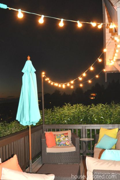Diy outdoor string light posts i love our current lights for Ideas for hanging patio string lights