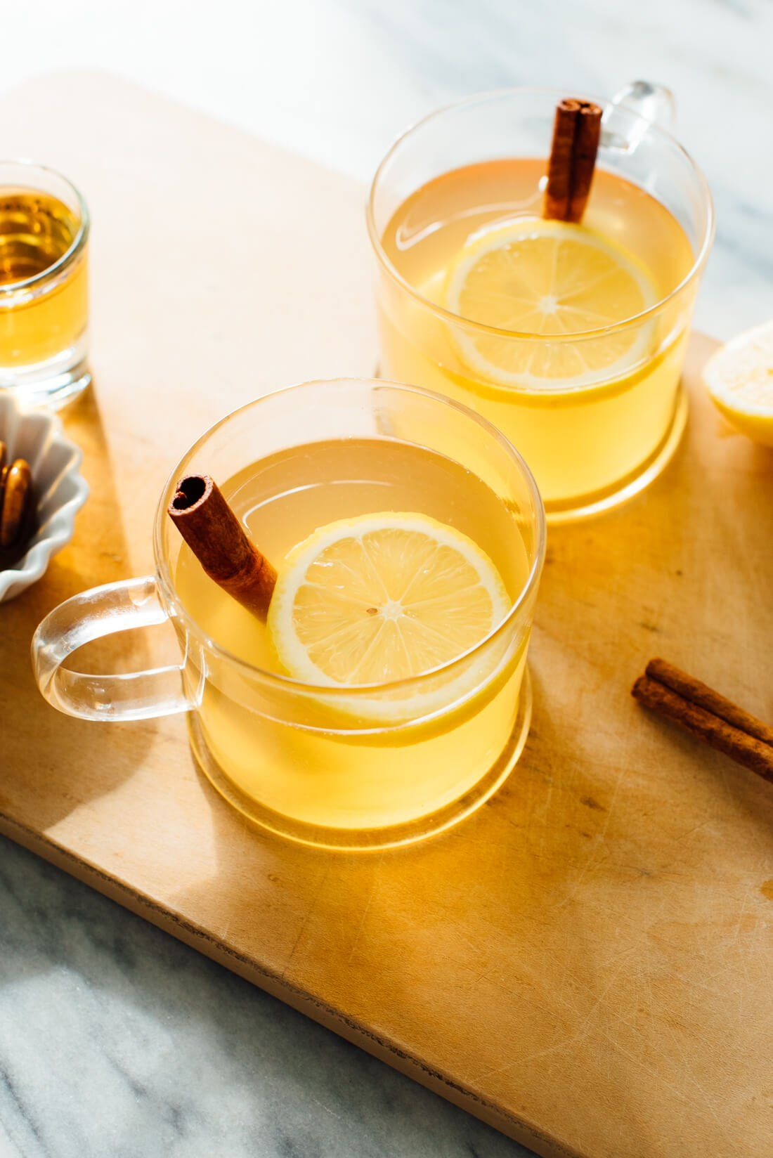 Warm up with this classic hot toddy cocktail recipe! Hot toddies are so easy to make. You'll just need hot water, whiskey, honey, and lemon. Cheers! #cocktail #christmasrecipe #whiskey #cookieandkate