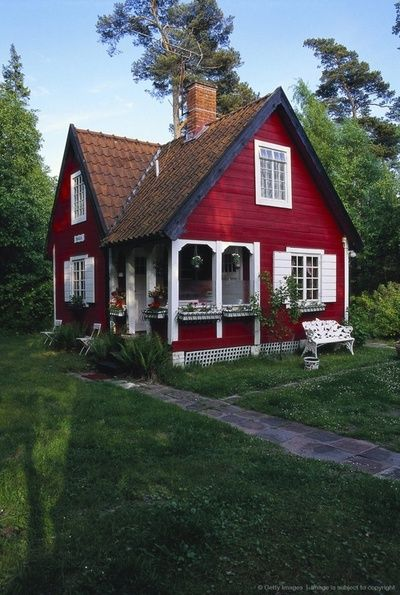 Darling little red cottage style house with white trim and shutters; love  the itty bitty tiny porch