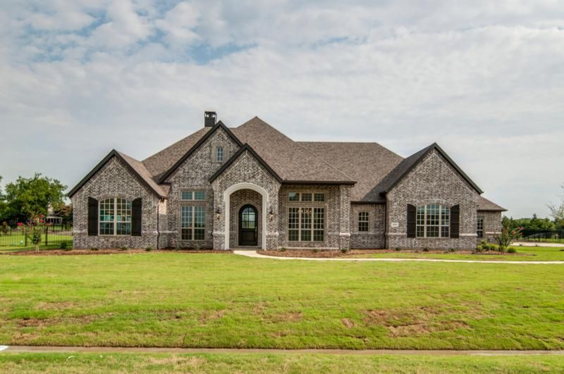 Let Us Build On Your Lot Paul Taylor Homes Dallas Fort Worth Texas Find A Home Builder Build On Yo Brick Exterior House Stone House Plans Stone Exterior Houses