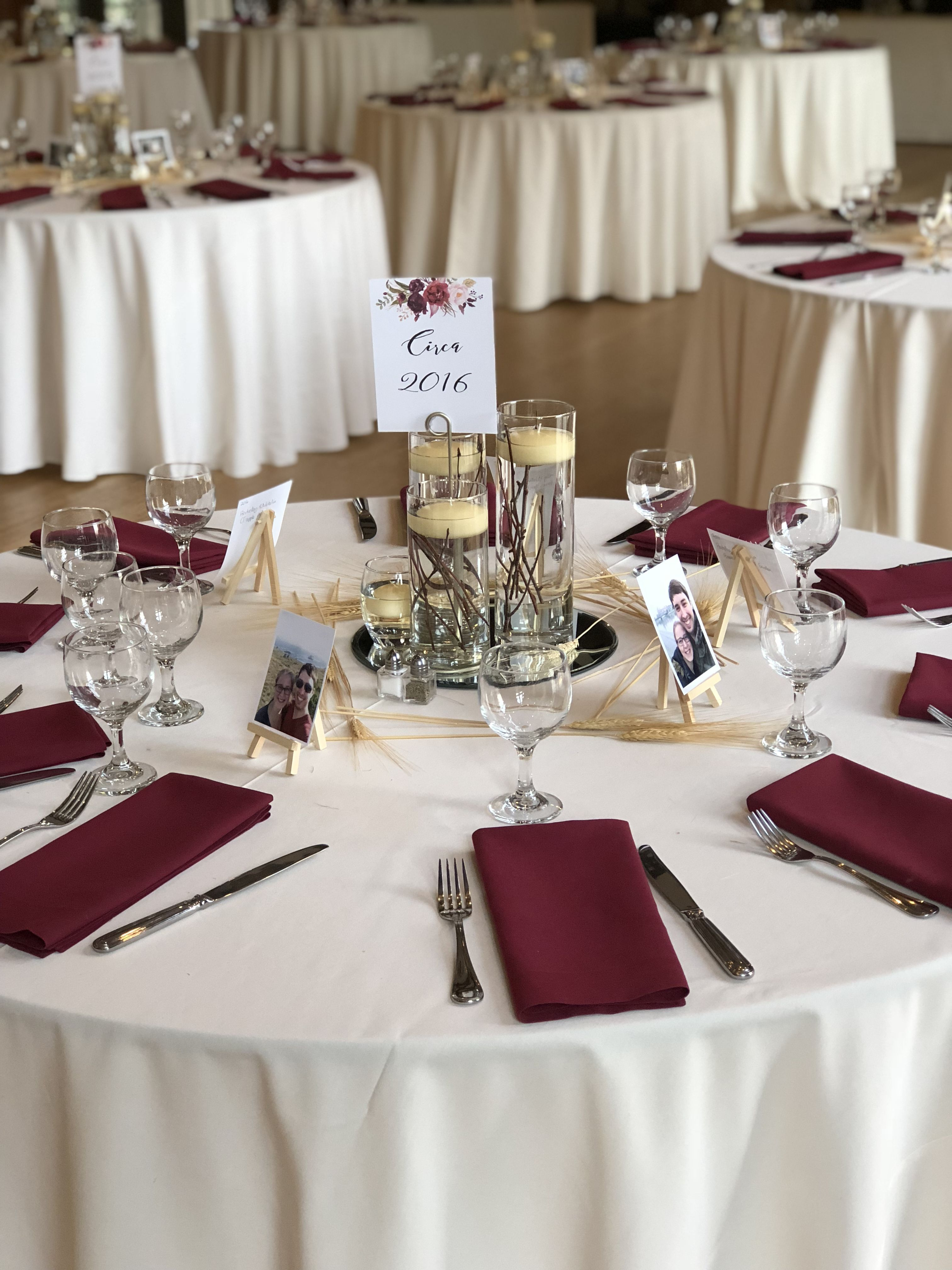 Wedding Table Linens.Ivory Table Linens With Burgundy Napkins Centerpieces And Floral