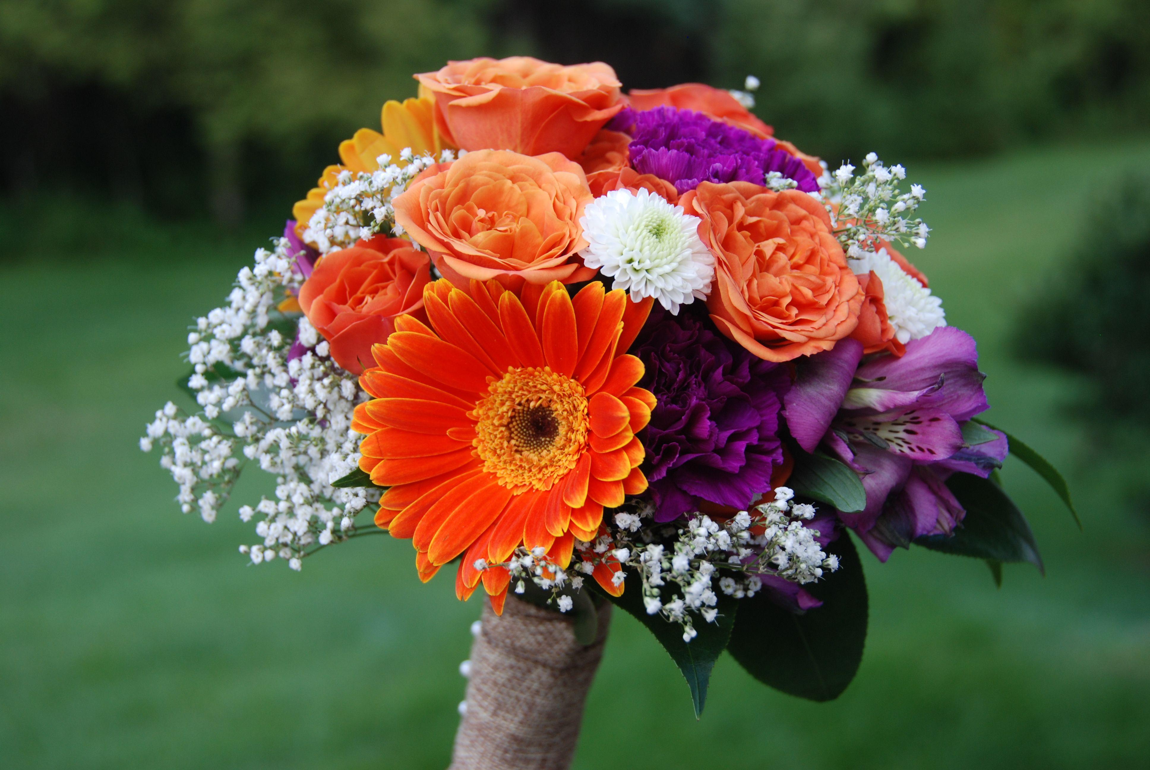 Fall wedding bouquet idea: Gerbera daisies, roses, babies breath, alstromeria, carnations, mums
