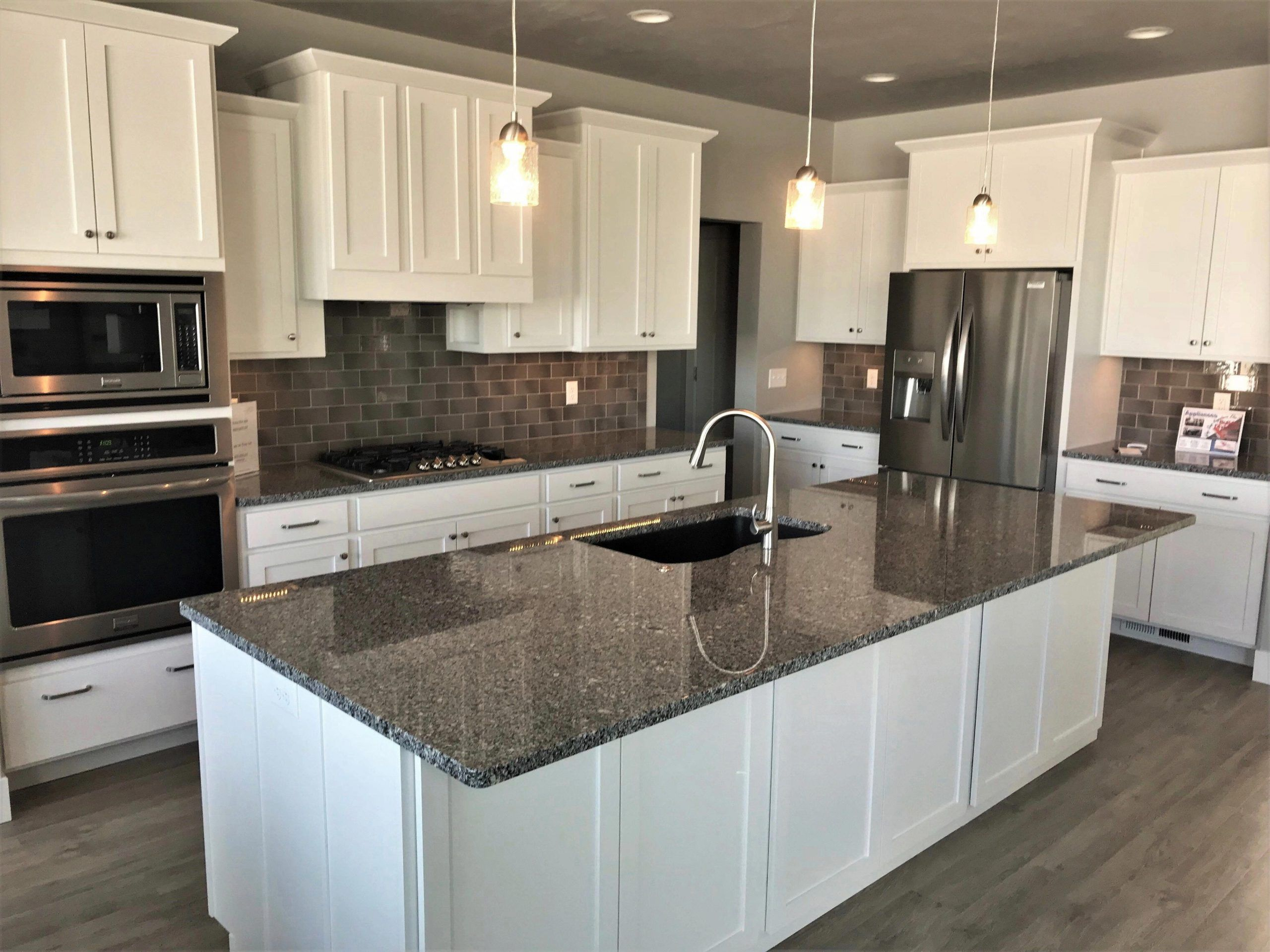 White cabinets with a stunning azul platino granite ...