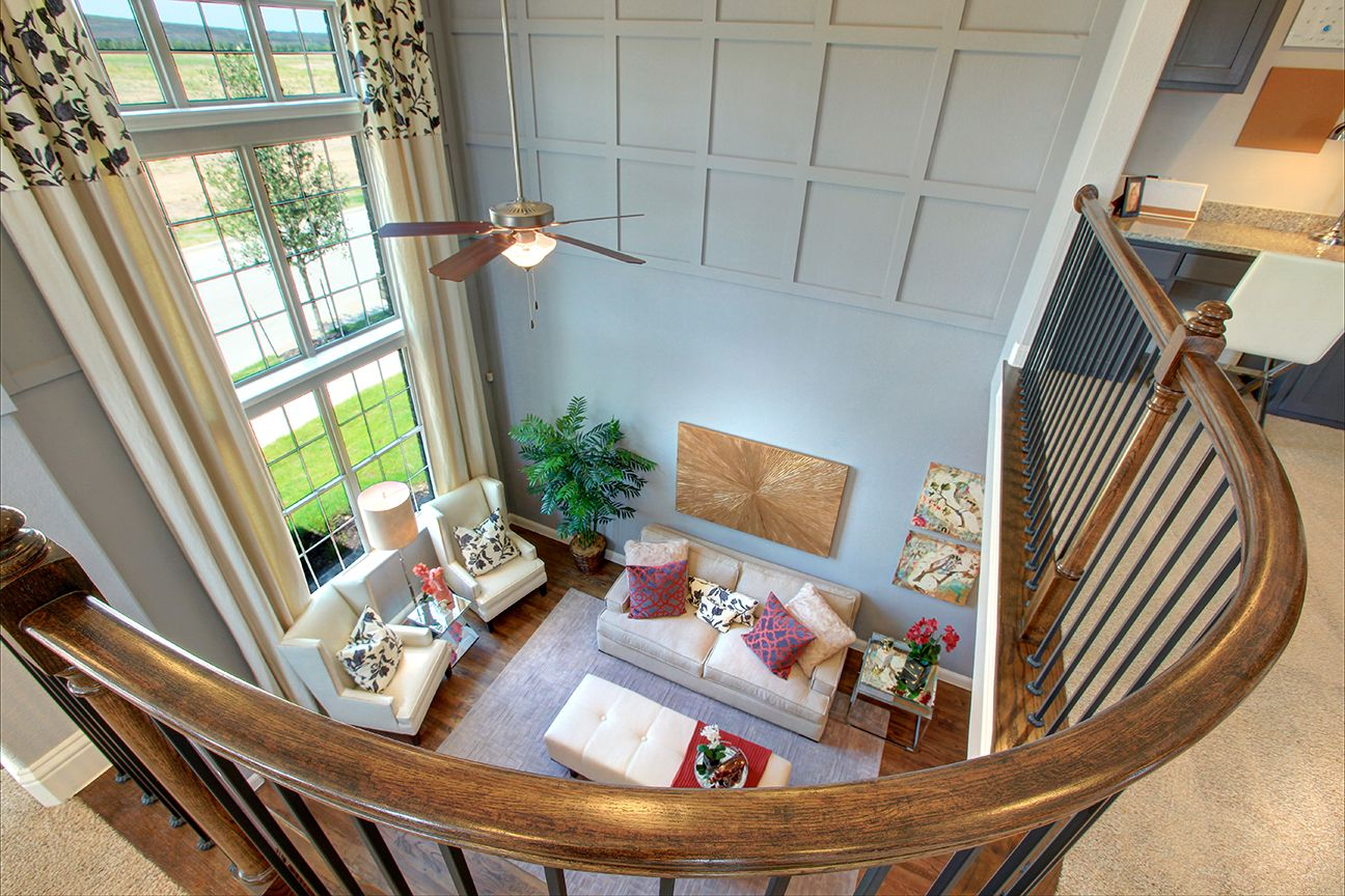 Use wainscoting trim just at top of two story room and paint in same ...