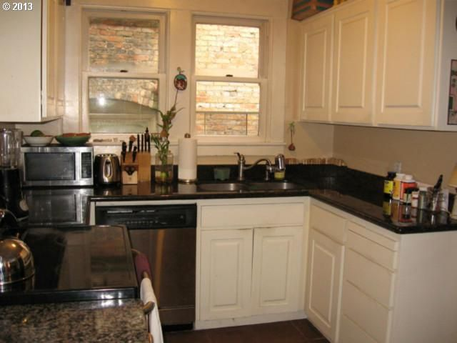Kitchen of Unit # 204. Cabinets are ok. View leaves much ...