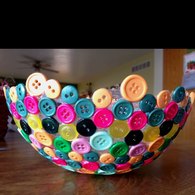 Glue buttons to a balloon.   Let dry.   Modge podge over the top.  Let dry.   Pop balloon. Button bowl!
