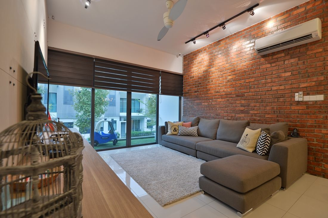 Contemporary terrace house living area using lovely red bricks as