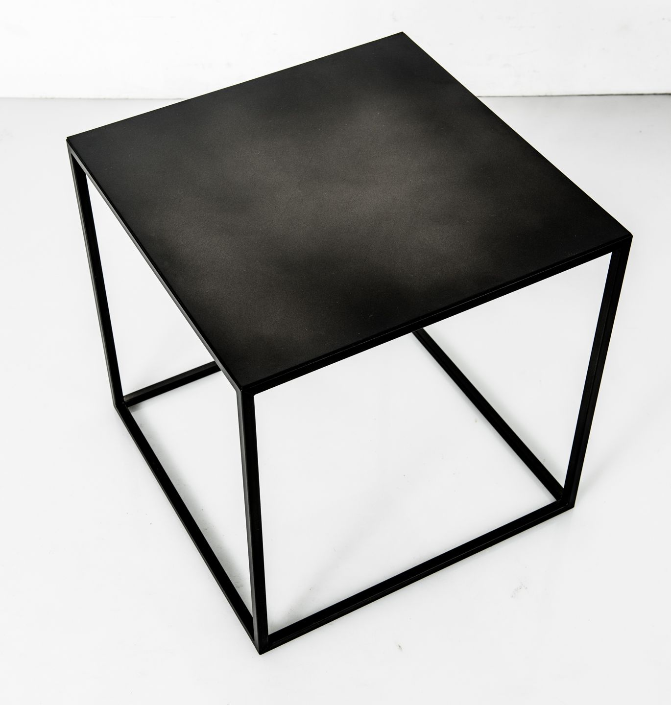 The Black Frisco is a black powder coated steel cube table