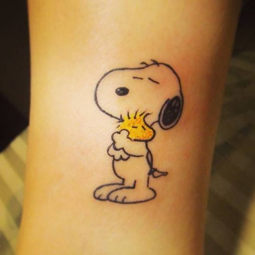 Snoopy And Woodstock Hugging Each Other Tattoo On The Inner Side