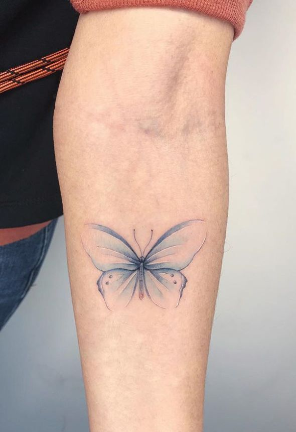 Photo of unique and small butterfly tattoo ideas on arm for woman