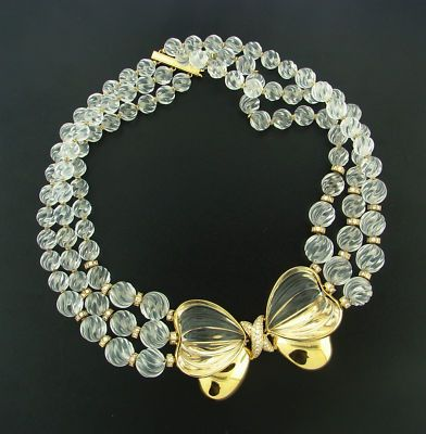 """Boucheron Rock Crystal, Diamond & 18k Gold Necklace, c.1950, Paris. The necklace features 3 strands of exceptional hand-carved rock crystal beads & bow with pave set round diamonds at the knot. The beads are spaced with gold rondelles some of which are set with diamonds. Total weight of diamonds is 2.30 carats. The carved rock crystal beads, are expertly graduated from ½"""" to ¼"""", to a final length of 15"""". The bow measures 2 ¾"""" x 1 ¾"""". 