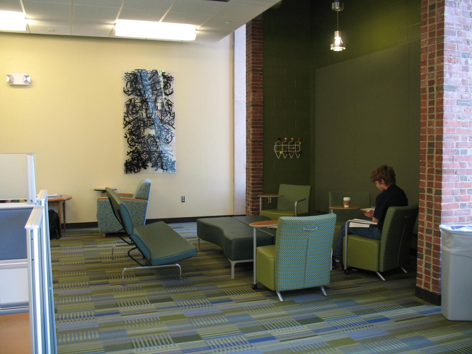 three chair styles share same large footrest/table. Note handle on chair back. And nice green wall! (U of R)
