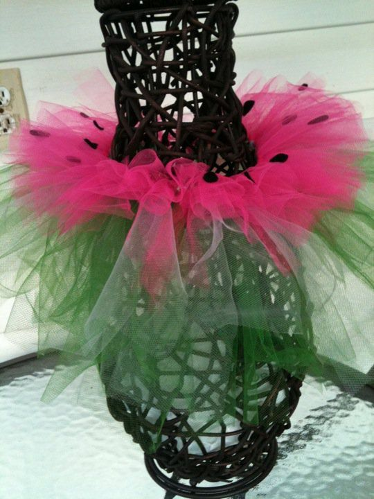 """This is a """"watermelon"""" tutu. It is a green tutu with white stripes on the bottom layer and hot pink on the upper layer. The pink layer has felt """"seeds"""" on it. It is very chic for a little girl.    Infant/Toddler 0-4T  $15"""