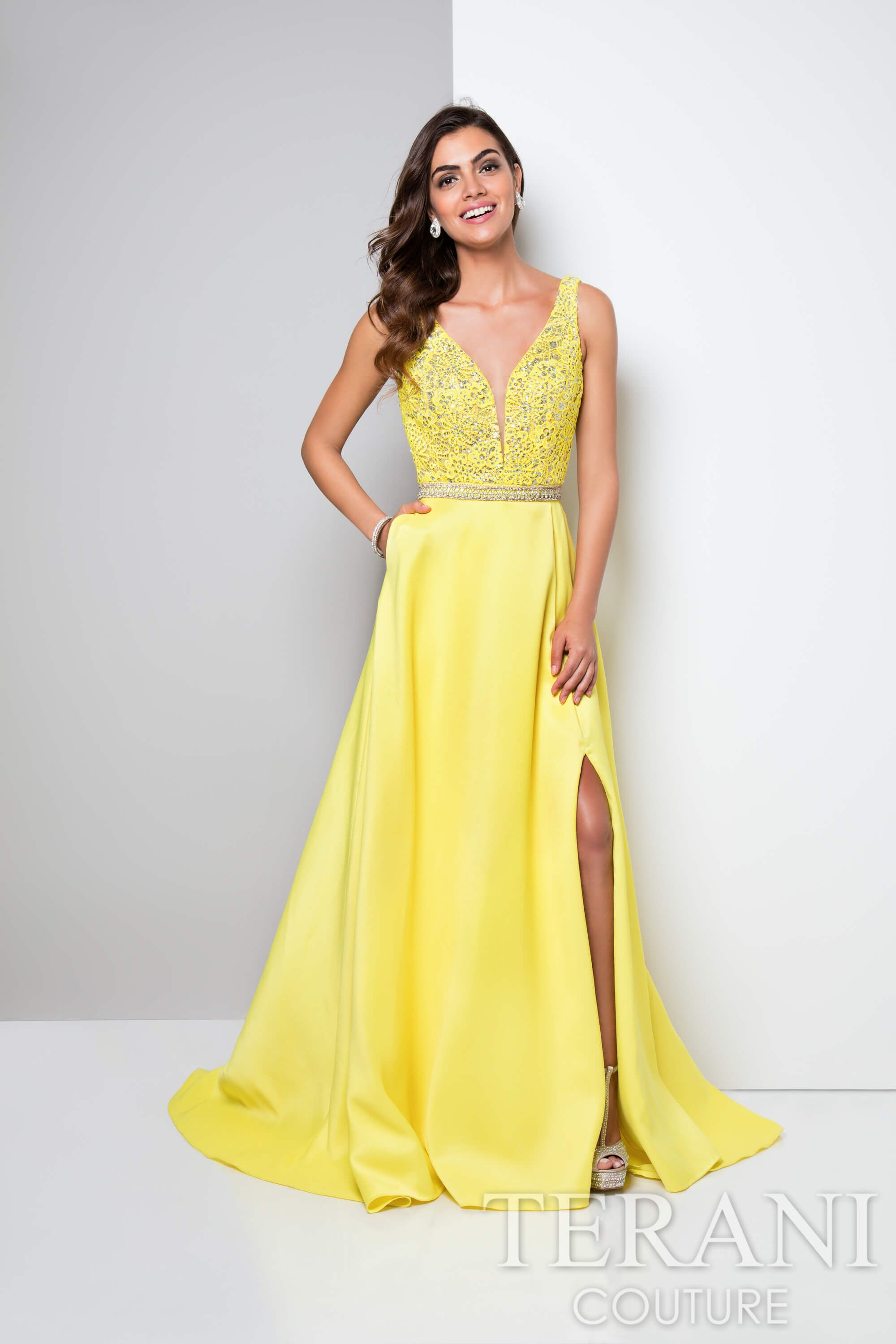 Yellow designer prom gown featuring a jeweled floral lace bodice