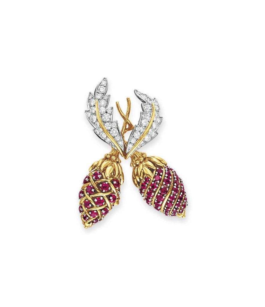 """A RUBY AND DIAMOND """"TWO FRUIT"""" BROOCH, BY JEAN SCHLUMBERGER, TIFFANY & CO.  Christie's President John F. Kennedy gave a similar brooch in 1960 to Jaqueline Kennedy upon the birth of their son, John F. Kennedy, Jr.  Jackie wore the brooch multiple time during his presidency.  It is most frequently in photos pinned to her red suit on her visit to Canada in 1961."""