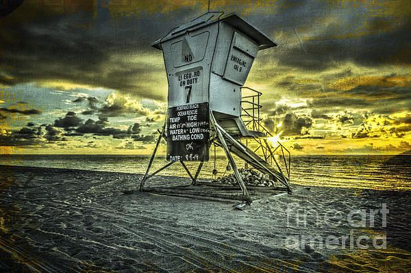 Lifeguard off duty at sunrise in Pompano beach florida.I added texture in the background with yellow and blue to blend in with the sun.