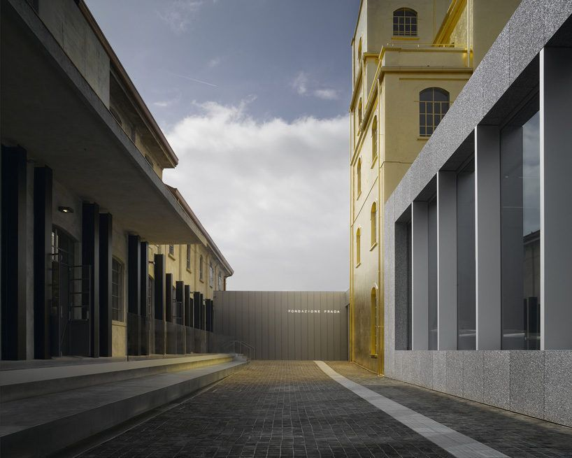 c6a345faa Rem Koolhaas's Fondazione Prada in Milan has clean lines, double columns,  brick walkways, cantilevered overhangs and even a metallic gold building.