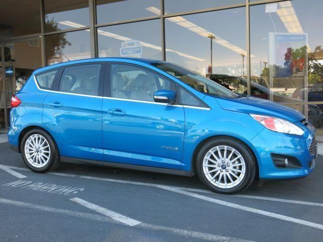 2013 Ford C-Max Hybrid, 31,959 miles, $18,950.