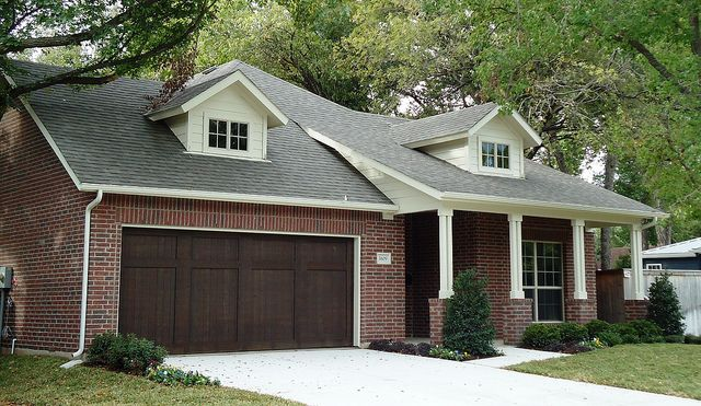 Village Homes: The Classic Red Brick, White Trim, And Dark Brown Stained Garage  Door!