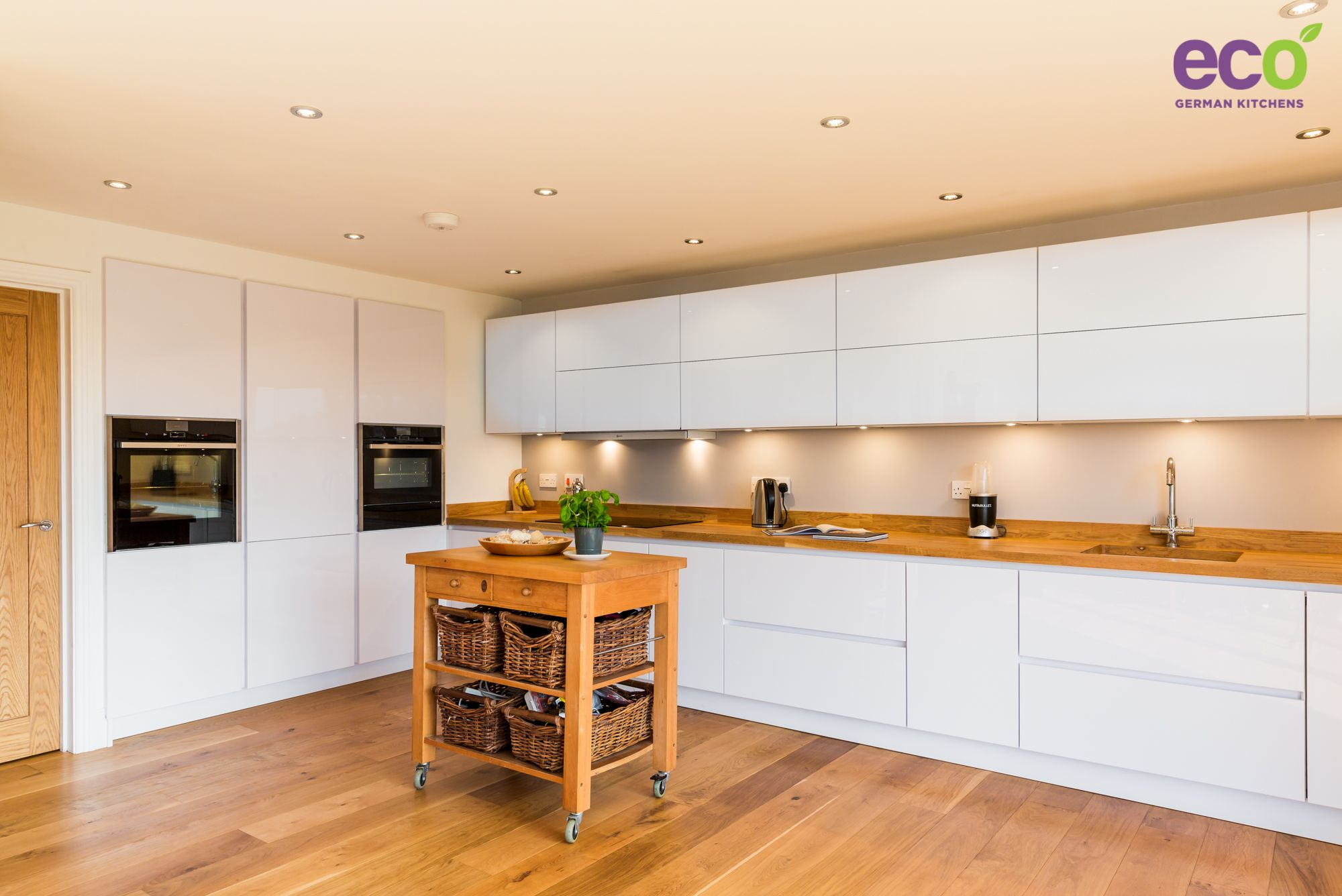 White And Wood Kitchen Stunning Handle Less High Gloss White Kitchen With Solid