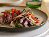 Fajitas....... nothing like flank steak that has been marinated in lime juice, olive oil and seasoning, grilled until juicy and tender and served on tortillas with fresh guacamole and sauteed onions and peppers!!!