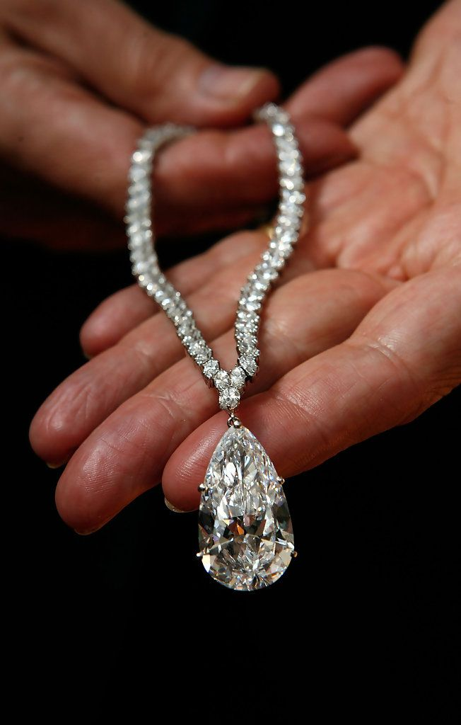 d98a0d5a1 The Christina Onassis Diamond (38 carats) held by the Christie's director  of jewellery on June 9, 2008 in London, England. The necklace is estimated  to ...