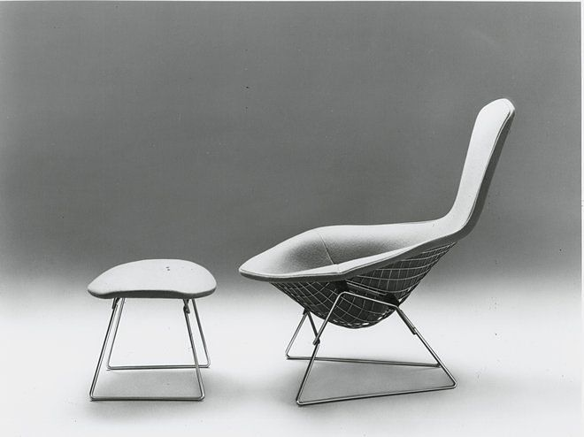 Bertoia's bird chair has a curved metal grid structure, a fabric seat, and matching ottoman.