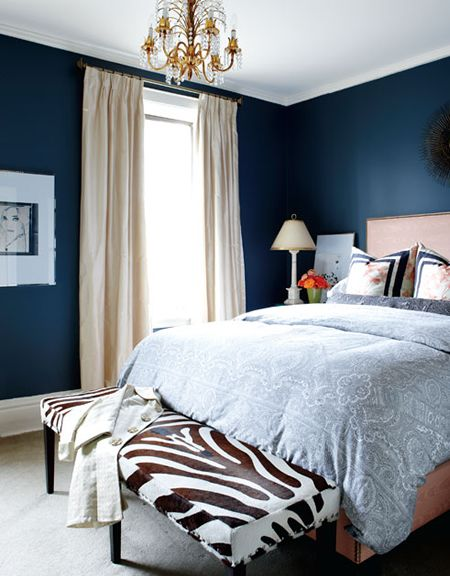 bedrooms - blue walls, zebra bench, ivory silk drapes, linen bed French brass nailhead trim, blue orange pillows, blue paisley blue duvet  Blue walls