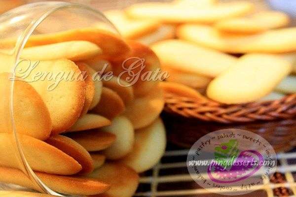 Lengua de Gato is a popular Filipino treat. These are easy-to-make light butter cookies. They are baked to a slight golden crisp that can be served with ice cream, chocolate drink or a cup of coffee. Lengua de Gato are thin cookies that look like the shape of a cat's tongue, that's why it is called Cat's Tongue Cookies in other countries and Lenguas de Chat in European countries.