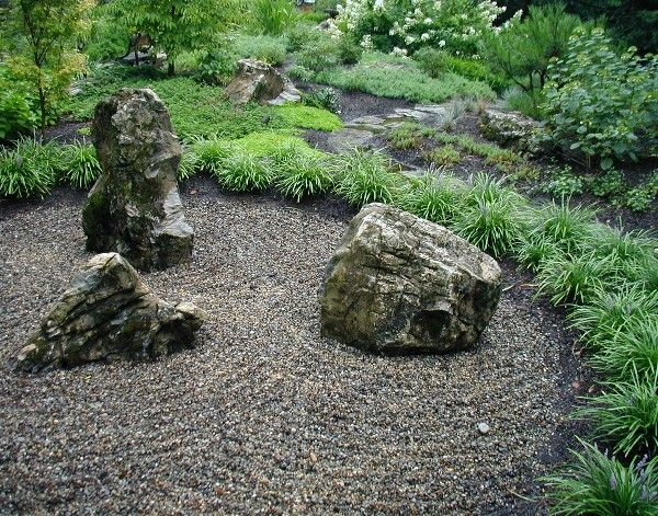 A Fieldstone Path Skirts The Linear Border Of Lirope Which Frames