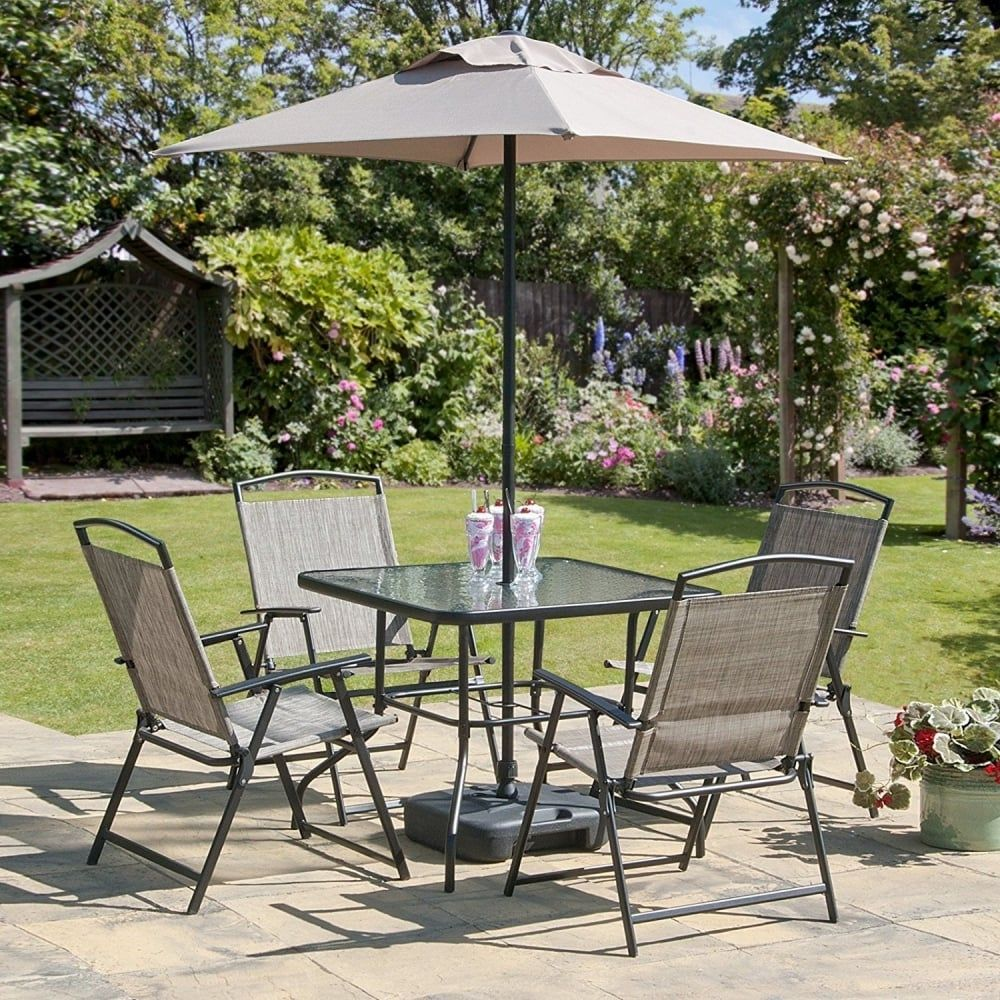 rattan patio chairs uk reupholstered dining outdoor garden furniture oasis set 7 piece folding