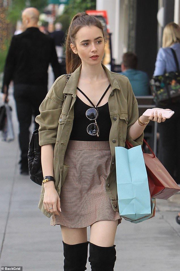 Lily Collins puts on stylish display in preppy min