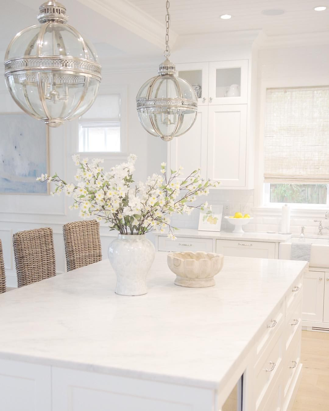 White Kitchen. Carrara Marble. Bamboo Roman Shades. Rattan