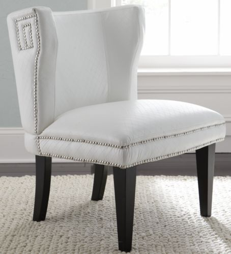this white faux leather chair with nailhead trim might work for the sitting area off the kitchen