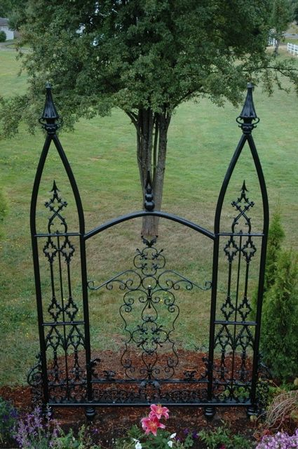 A custom garden trellis in memory of James F. Neal   by Thor Myhre,   constructed in the  Gothic Revival Style. This trellis is 12 feet high.