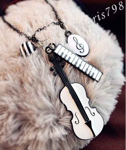 Music Themed Jewelry Fashion Pretty Charming Musical Style Sweet Instruments Piano Violin Musical Note Pendant Long Necklace. $3.99, via Etsy.