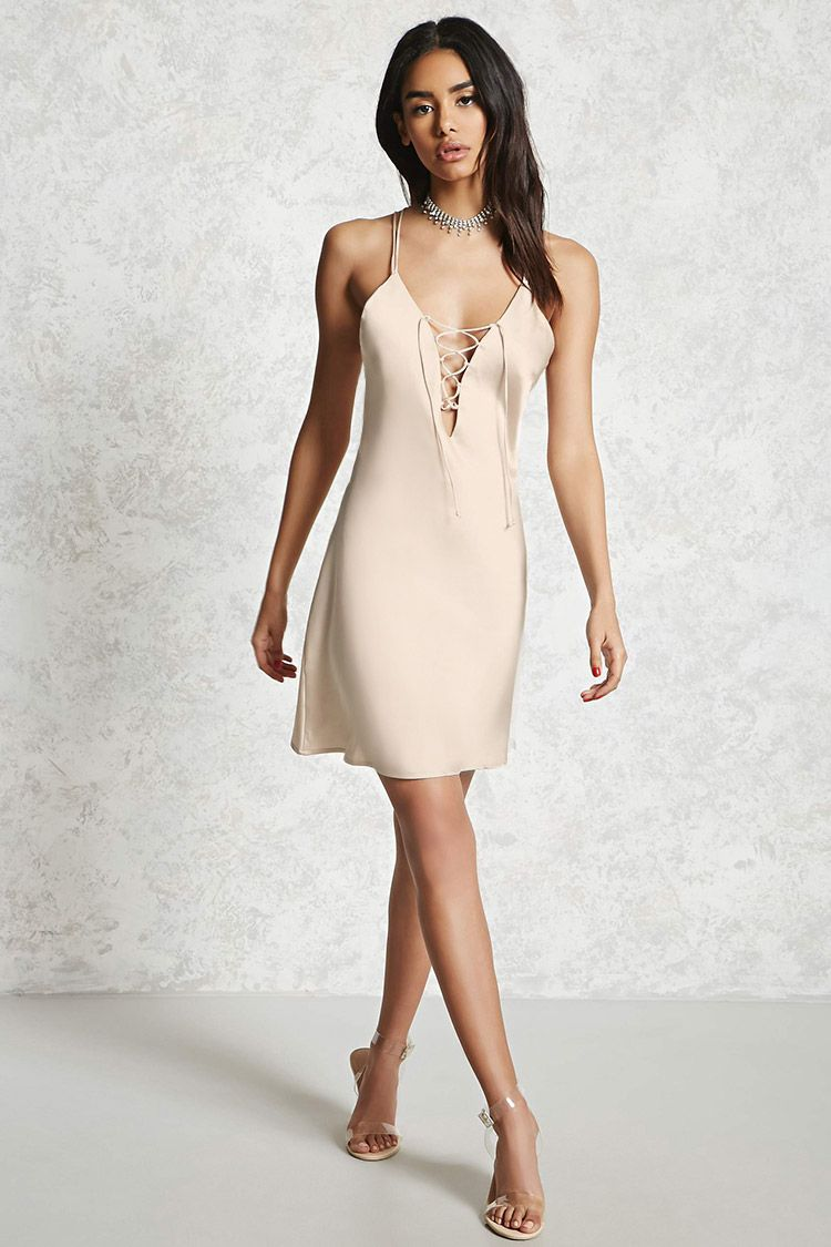 A Satin Slip Dress Featuring Plunging Neckline With Lace Up Front And Dual Cami Straps That Cross In The Back