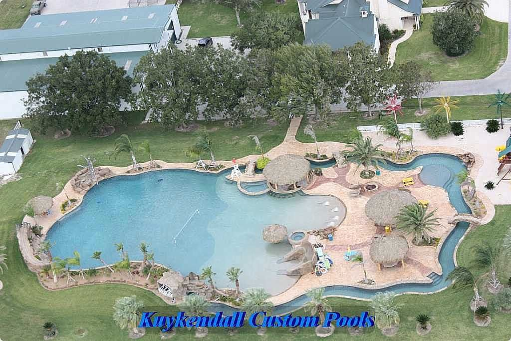 World 39 s largest backyard swimming pool gives texas home a for Custom swimming pools
