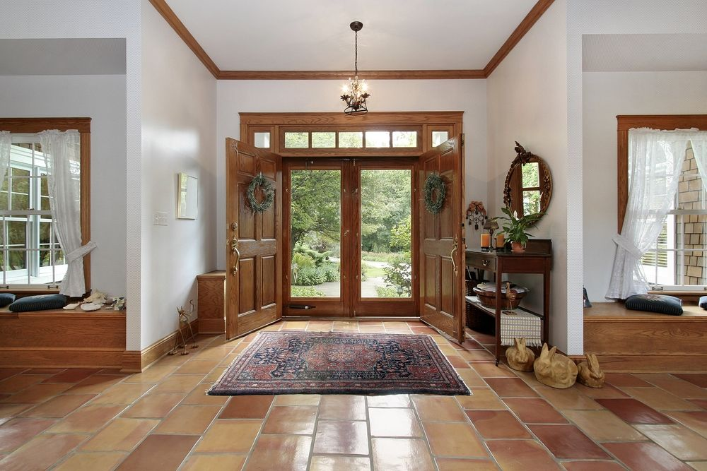 One story foyer with brown tile floor opening up to the left and right of36 Different Types of Home Entries  Foyers  Mudrooms  etc  . Entrance Floor Tiles Design Images. Home Design Ideas
