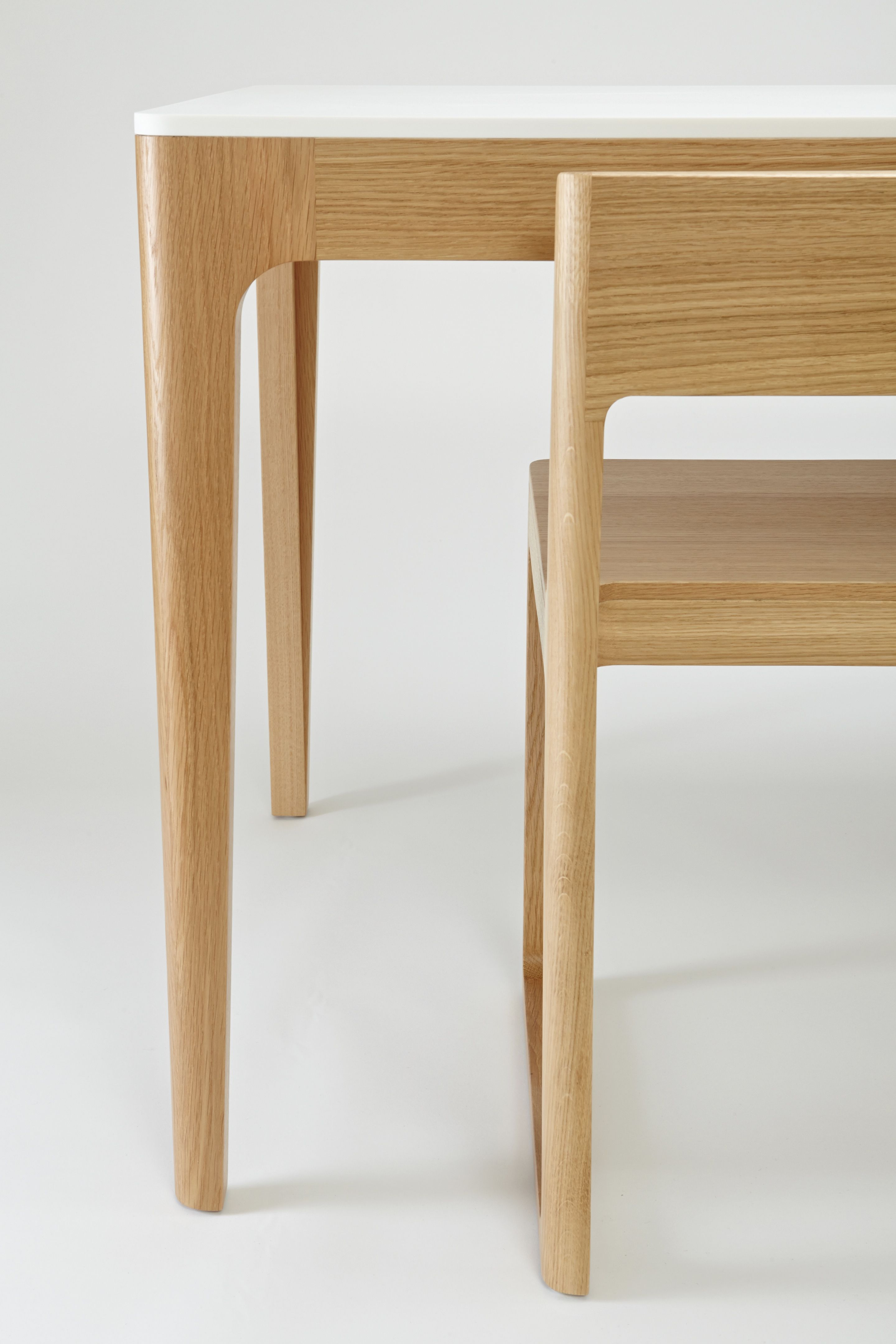 The BarberOsgerby designed Home Dining Table with a Corian top ...
