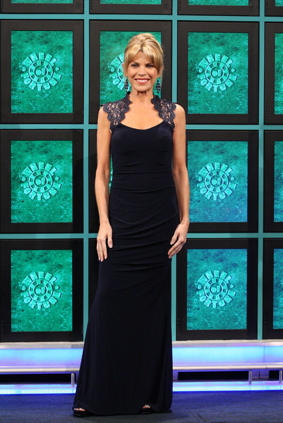Vanna White wearing a black metallic lace ruched Caché gown ...