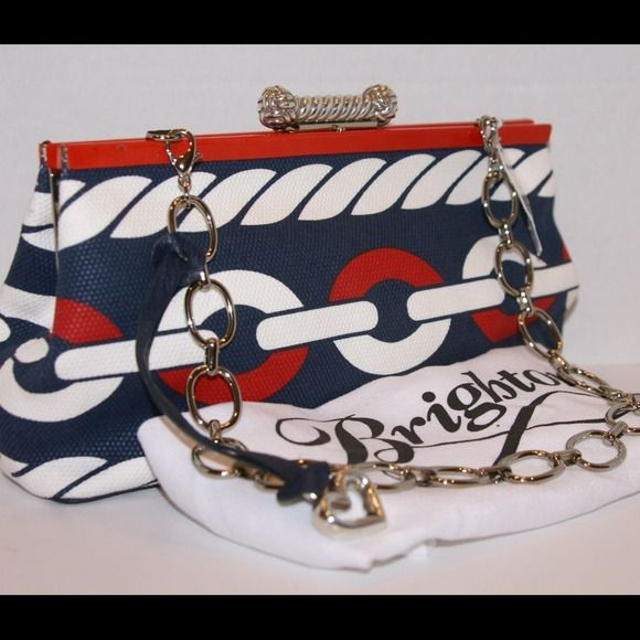 """Brighton Cutter Handbag or Clutch  Host Pick  Nautical themed handbag or clutch with tuckable chain strap. Red, White and Blue adorn the beautiful exterior canvas as well as the polka dotted lining. 3 card slots and 1 zippered pocket.  Brighton iconic heart hanging leather tag.  Measures ~10.5"""" L x 5.5"""" x 2.25"""".  This cutie was purchased at a Brighton outlet store.  There is a very minute flaw in the patent leather trim and mark made by the store on the inside; the price reflects a discount…"""