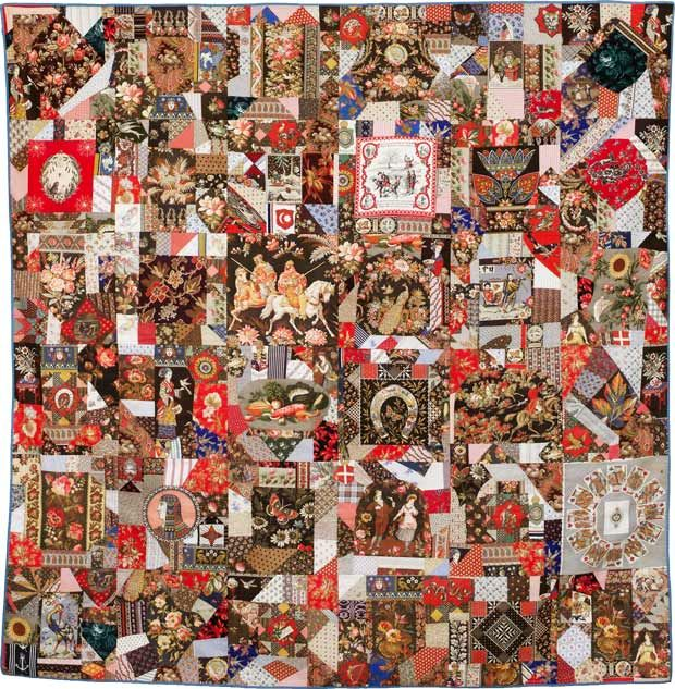 A crazy quilt with a smorgasboard of image-patterned fabrics. Knights, scenes of young love, Queen Elizabeth, playing cards, a horseshoe, hundreds of flowers…