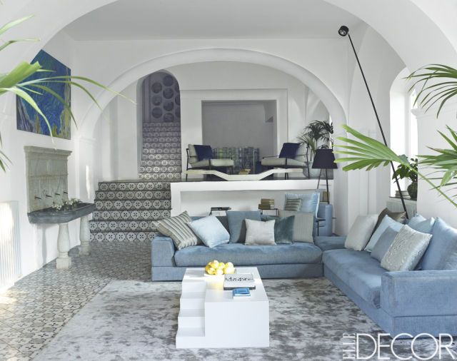 The living room sofas by Arketipo are upholstered in a fabric by Gastón y Daniela, the cocktail table is by Mogg, the marble fountain is from the 18th century, and the custom-made rug is by De Dimora.   - ELLEDecor.com