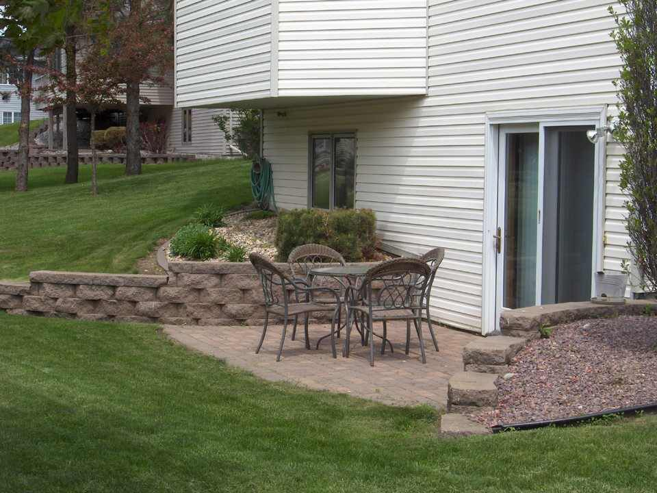 I like the blocks in this wall for basement walkout patio for Walkout basement backyard ideas