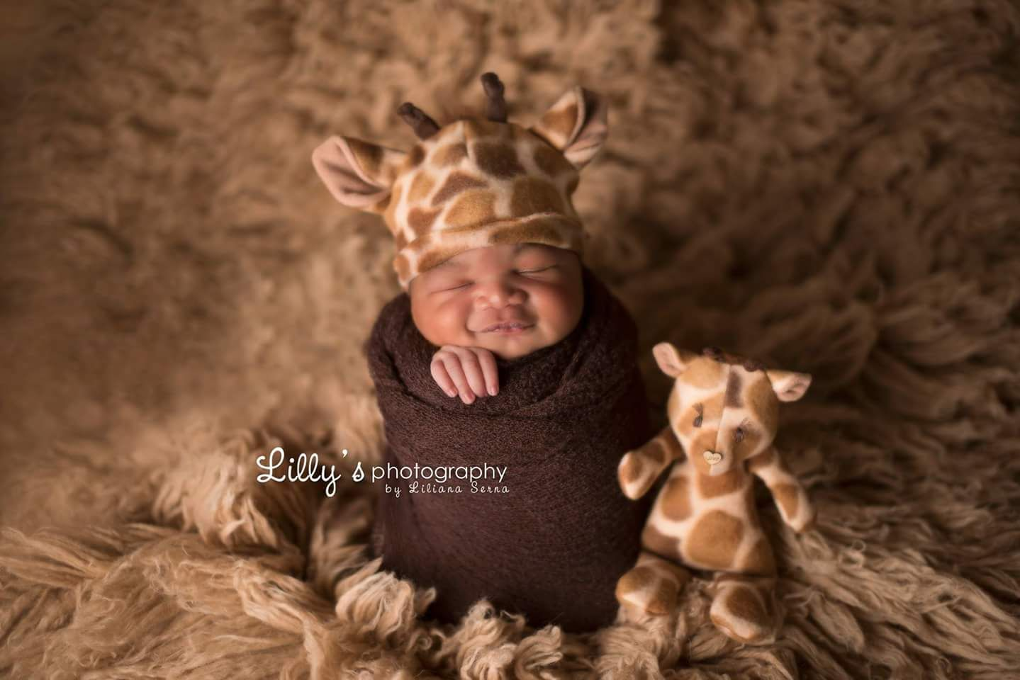 The ginger newborn baby beanie and lovie are made out of a cute giraffe print fleece