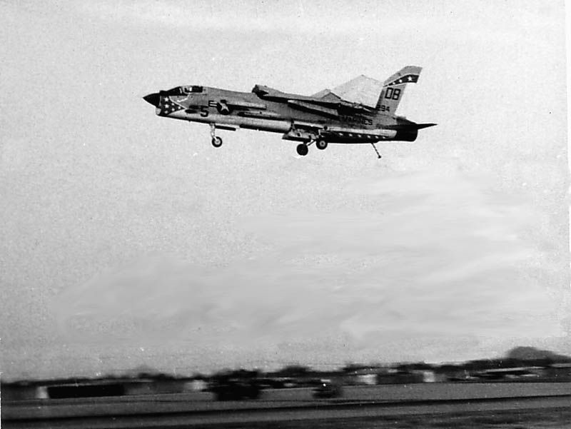 A Marine F-8 in flight with folded wings | Marine Aviation
